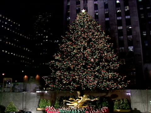 giant norway spruce w/ lights on in rockefeller plaza new york city manhattan - rockefeller center christmas tree stock videos & royalty-free footage