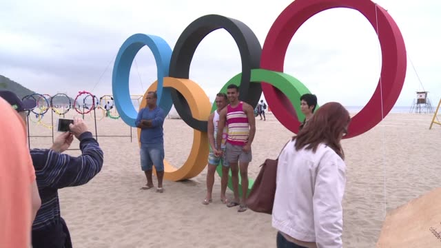 giant olympic rings made of recycled plastic bottles were inaugurated thursday on the beach of copacabana rio de janeiro 15 days before the opening... - olympic rings stock videos & royalty-free footage