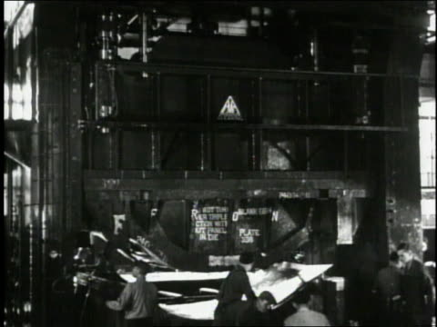 1940 ws a giant press shaping a steel plate at a car factory / united states - 1940 stock videos and b-roll footage