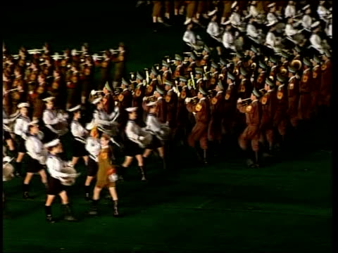 giant propaganda parade/ decision to evict western aid agencies north korea pyongyang ext women dressed as sailors with drums participate in the 2005... - parade stock videos & royalty-free footage