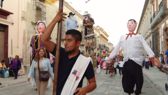 giant puppets at a traditional calenda street parade in oaxaca, mexico - puppet stock videos & royalty-free footage