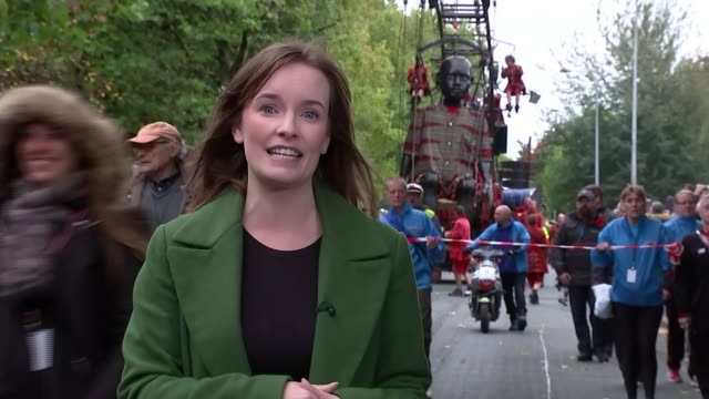Giant puppets take part in final parade through Liverpool ENGLAND Liverpool EXT Twenty foot tall puppet of a black child being moved through the city...