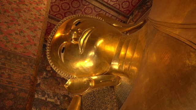 Giant reclining buddha at Wat Pho Temple in Bangkok, Thailand