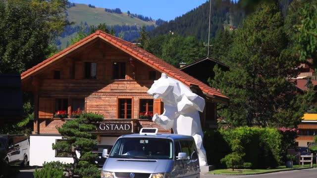 giant sculpture by artist richard orlinski represents a giant bear in front of a luxury chalet on august 7, 2020 in gstaad, switzerland. gstaad is... - chalet stock videos & royalty-free footage