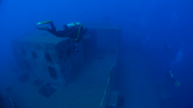 giant shipwreck, diver, scuba diving - deep sea diving stock videos & royalty-free footage