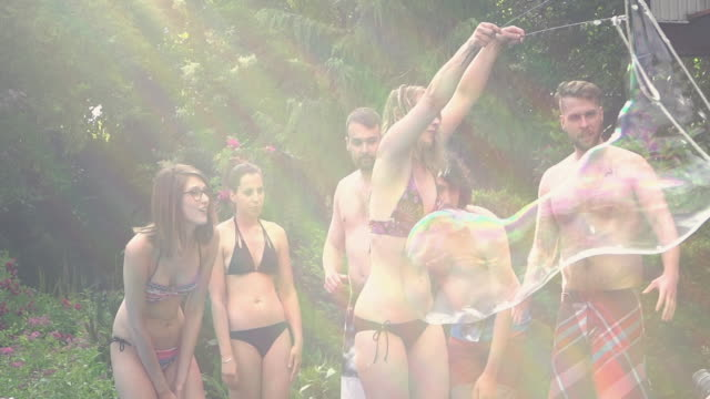giant soap bubbles young adult pool party outdoor summer bbq - summer heat stock videos & royalty-free footage