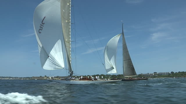 Giant spinnakers power the yachts Ranger and Velsheda in close competition in the J Class Regatta.