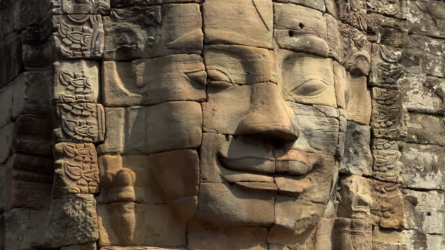 zo / giant stone face tower of bayon temple - cambodia stock videos and b-roll footage