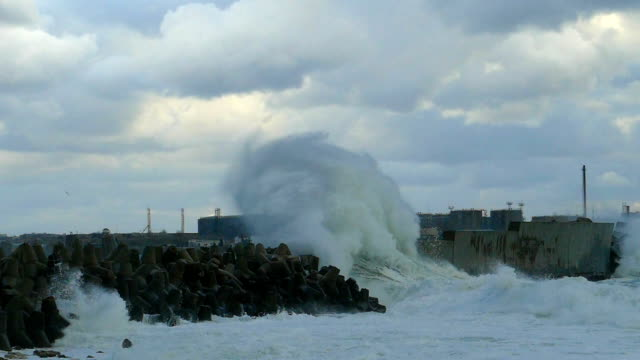 giant waves breaking on breakwater port (slow motion) - coastal feature stock videos & royalty-free footage