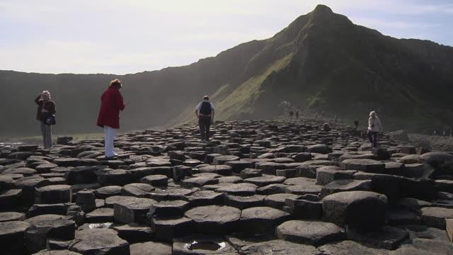 WS Giants Causeway basalt rock formations with tourists / County Antrim, United Kingdom