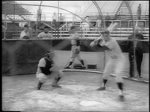 giants player harvey kuenn hitting ball running during spring training / newsreel - spring training stock videos & royalty-free footage