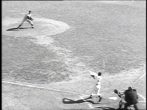 vídeos de stock, filmes e b-roll de giants rookie willie mays hits in the first run of game 2 of the 1951 world series between the yankees and giants / new york city, new york, united... - 1951