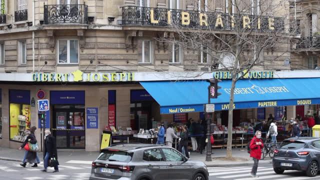 gibert joseph bookstore, 26 bouvelard saint michel in paris - book shop stock videos & royalty-free footage