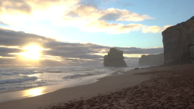 gibson steps beach at sunset in port campbell national park on the great ocean road, victoria state, australia. - port campbell national park stock videos & royalty-free footage