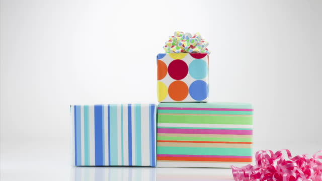 gift boxes and bows disappearing on white background - medium group of objects stock videos & royalty-free footage