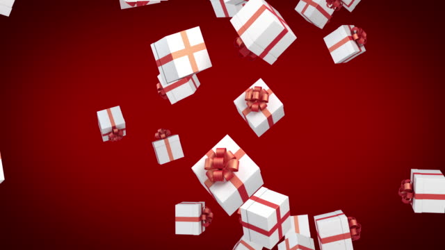 gift boxes are falling on red background - christmas present stock videos & royalty-free footage