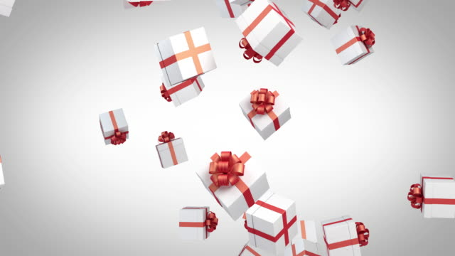 gift boxes are falling on red background - christmas gift stock videos & royalty-free footage