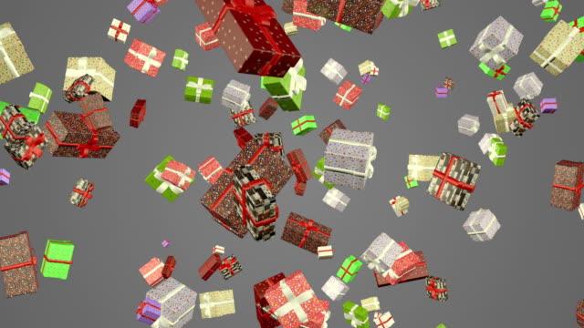 vídeos de stock, filmes e b-roll de caixas de presente que caem o fundo cinzento da animação do laço - efeito especial