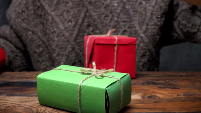 gift boxes in hands - mitten stock videos and b-roll footage