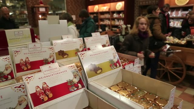 gift boxes of marzipan confectionery are displayed for sale in the factory shop at the niederegger gmbh co marzipan factory in lubeck germany on... - shop sign stock videos and b-roll footage