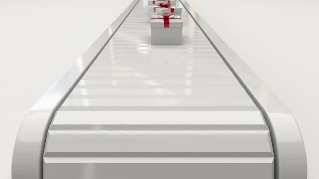 gift boxes on conveyor belt - conveyor belt stock videos & royalty-free footage