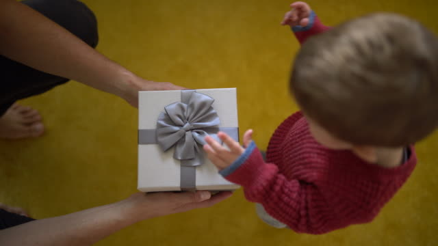 gift for a baby - giving stock videos and b-roll footage