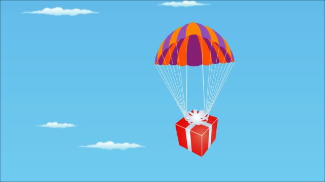 geschenk vom himmel - fallschirm stock-videos und b-roll-filmmaterial