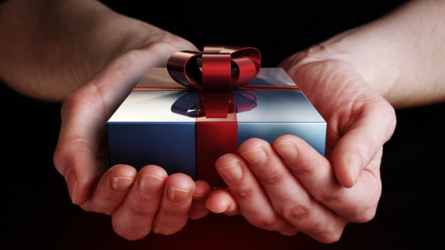 gift in hands - gift box stock videos & royalty-free footage