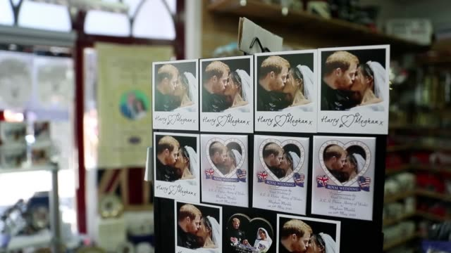 a gift shop in windsor selling mugs featuring prince harry and meghan's kiss on the steps of st george's chapel 24 hours on from the couple's wedding - sussex stock videos and b-roll footage