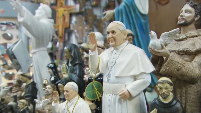 gift shop sells pope francis memorabilia. - religion or spirituality stock videos & royalty-free footage
