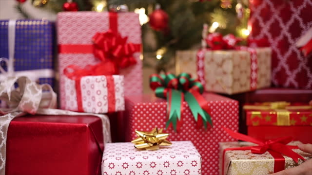 gifts stack for christmas day - giving stock videos & royalty-free footage