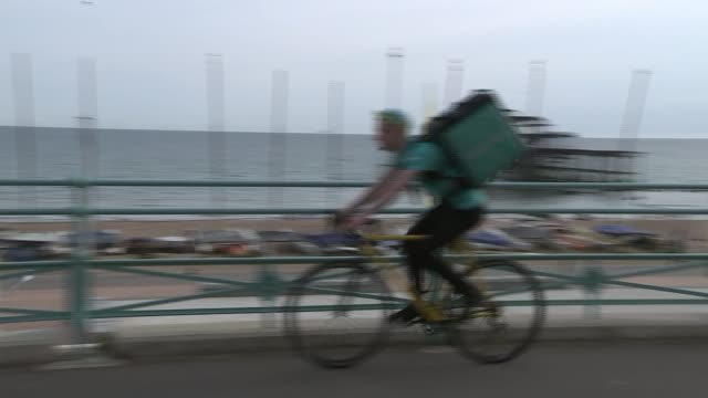 Supreme Court rules worker claimed to be selfemployed was entitled to employment rights UK East Sussex Brighton Deliveroo courier riding bicycle...