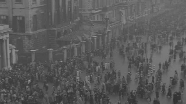 a gigantic crowd disperses following the funeral processional of king george v in london. - british royalty stock videos & royalty-free footage