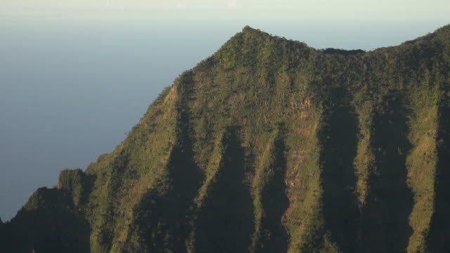 gigantic spine of mountain on kauai island - butte rocky outcrop stock videos & royalty-free footage