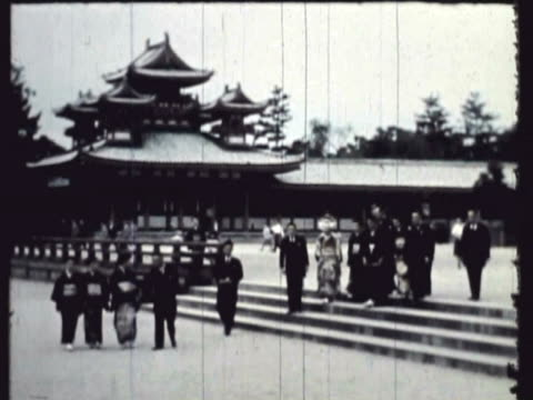 WS Gigantic Tori (gateway to the Gods) at Heian Temple, guardian (Shinto) shrine of Kyoto; 'costumed wedding party / Kyoto, Japan / AUDIO