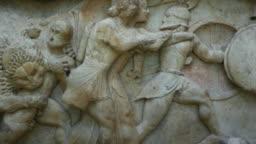 Gigantomachy battle in ancient greek stone frieze