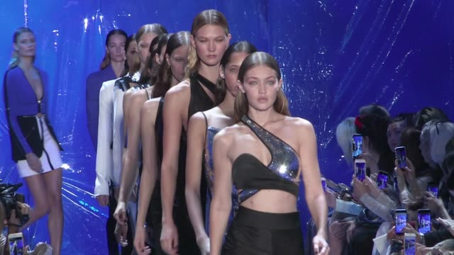 gigi hadid almost fall on the runway for the mugler fashion show but handle it like a boss. models on the runway for the mugler ready to wear fashion... - handle stock videos & royalty-free footage