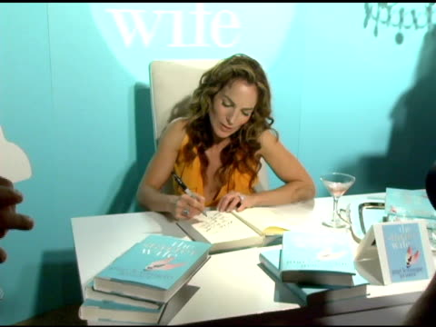 gigi levangie grazer autographing copies of her book at the launch party for gigi levangie grazer's new novel 'the starter wife' at the beverly... - autographing stock videos and b-roll footage