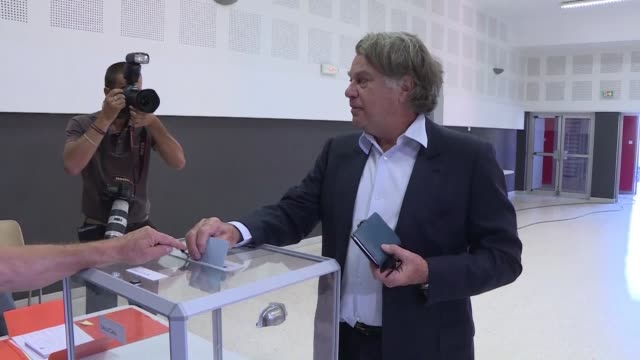 Gilbert Collard of the anti immigration National Front casts his ballot in Gallician in the second round of France's parliamentary elections
