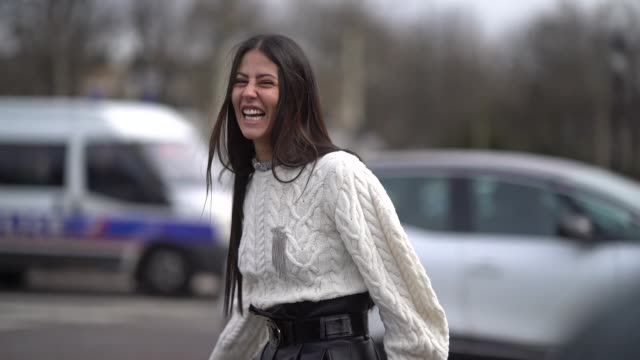 stockvideo's en b-roll-footage met gilda ambrosio wears a white top black leather pants white shoes outside chanel during paris fashion week womenswear fall/winter 2018/2019 on march 6... - week