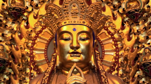 cu zo gilded buddha statue at longhua temple, shanghai, china - gilded stock videos & royalty-free footage