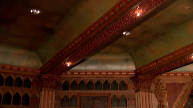 gilded ceiling beams and decorative wood panels adorn the interior of an art deco cinema, tooting, london. available in hd. - decorative art stock videos and b-roll footage