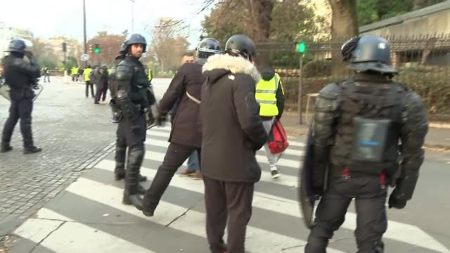 over a thousand arrested as riots continue FRANCE Paris Various shots Sebastian being moved on by riot police Sebastian interview SOT