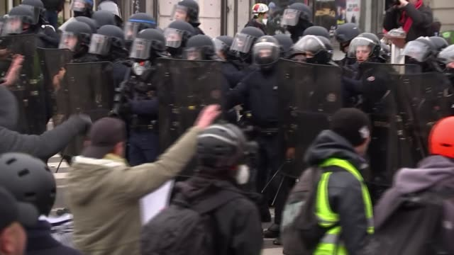 Yellow vest protests continue into ninth weekend France Paris protesters by the Arc de Triomphe wearing yellow vests and masks smoke bombs riot...