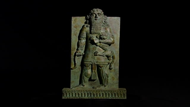 gilgamesh sculpture long shot on stone relief isolated on black - antique stock videos & royalty-free footage