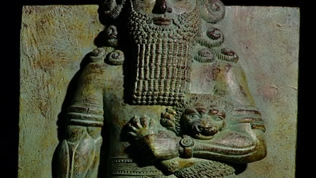 gilgamesh sculpture mcu tiltdown on stone relief isolated on black background showing gilgamesh holding lion and snake - antique stock videos & royalty-free footage