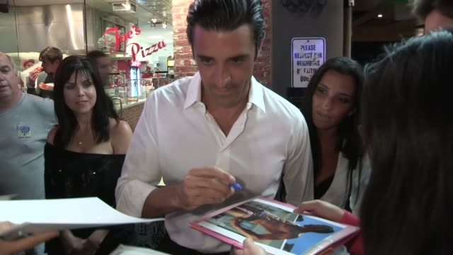 gilles marini carol marini greet fans at playhouse in hollywood 04/04/13 - playhouse stock videos and b-roll footage
