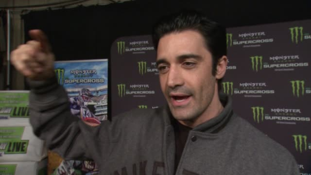 gilles marini on how much he loves to ride, how he can't jump as high as the pros, and how he rides around at monster energy supercross celebrity... - angel stadium stock videos & royalty-free footage