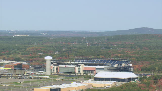 AERIAL Gillette Stadium and city skyline beyond / Foxborough, Massachusetts, United States