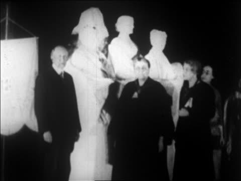 Gillette standing with Carrie Chapman Catt other women / newsreel